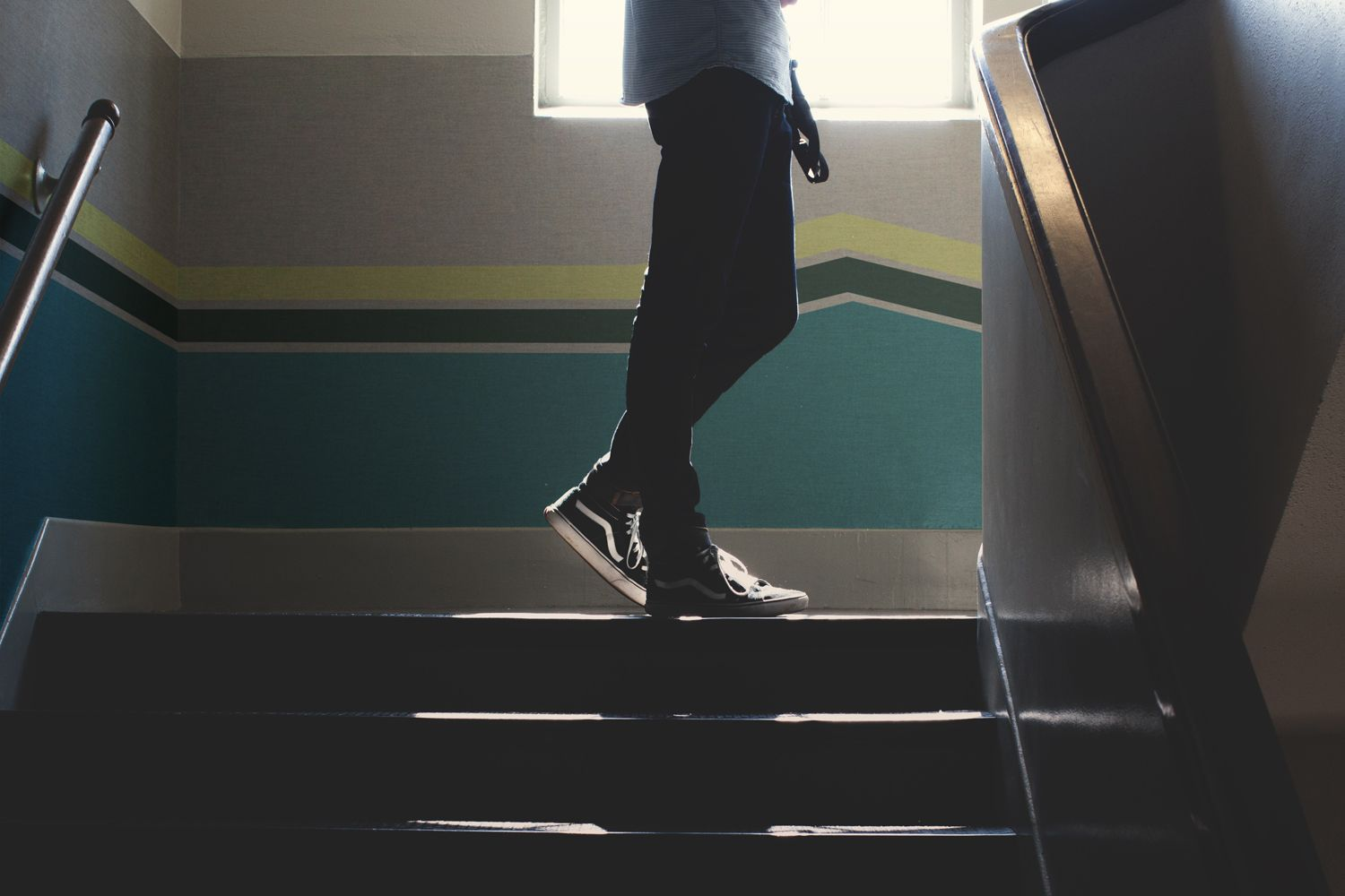 young man walking up the stairs