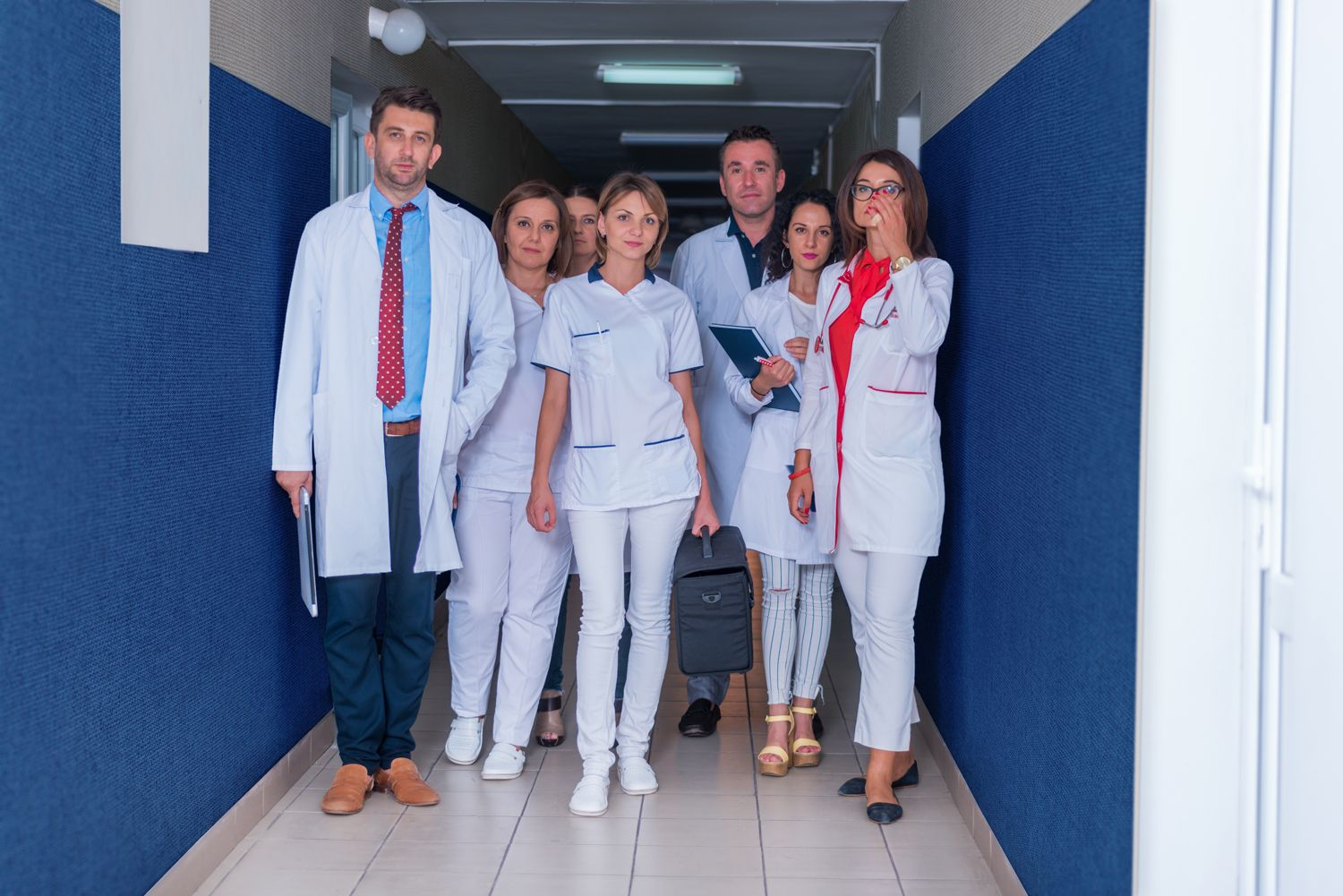 hospital hallway with parallel fabric panel with doctors and nurses posing