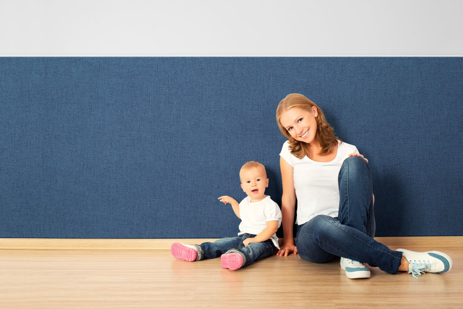 mother and child enjoying their fabricmate fabric panel wainscoting